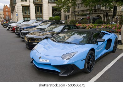 LONDON, ENGLAND - JULY 30: Supercars parked outside the Dorchester Hotel  on July 30, 2016 in London. One of the best places in the world to spot super cars, especially after Ramadan.