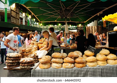 LONDON, ENGLAND- JULY 7, 2013; Bread and pastries on display at a bakery stall in Borough Market, London. A market has traded in the London Borough of Southwark for more than 250 years, UK