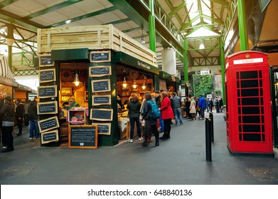 LONDON, ENGLAND- JULY 7, 2013; Unidentified people in Borough Market, London, UK.  A market has traded in the London Borough of Southwark for more than 250 years