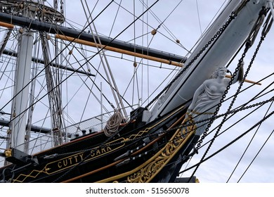 LONDON, ENGLAND - JULY 7, 2016: Female nautical figurehead on the bow of Cutty Sark, the world's sole surviving tea clipper, and fastest ship of her time, now an award-winning visitor attraction.