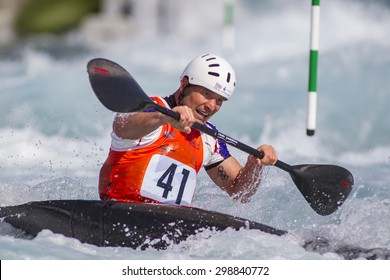 LONDON, ENGLAND - JUNE 06 2014 Richard Hounslow of Great Britain competes at the ICF Canoe Slalom held at the Lea Valley White Water centre Waltham Abbey.