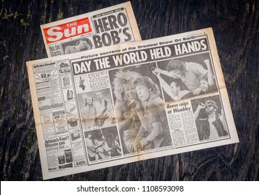 London, England - June 08, 2018: British Newspaper The Sun reporting on the charity live music event, Live Aid held at Wembley Stadium, London, 13th July 1985 the event was organised by Sir Bob Geldof
