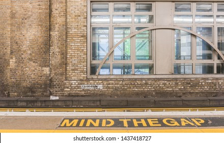 London, England - June 08, 2019: Mind the gap sign on platform 1 in the Charing Cross station, central London.