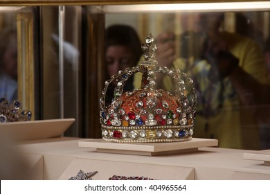 LONDON, ENGLAND - JUNE 11, 2015: The British Crown Jewels on display at the Tower of London. The jewels were moved from Westminster Abbey to the Tower of London due to a series of thefts.