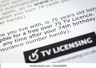 London, England - June 11, 2019: Close up of Television Licence for the United Kingdom, The fee is paid yearly and is used to fund the BBC services