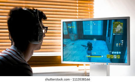London, England - June 13, 2018: Teenager playing Fortnite video game, Fortnite is a web based multi player survival game developed by Epic Games.