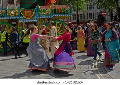 London, England. June 16th, 2019. Rathayatra London. From Hyde Park to Trafalgar Sq.  Wooden carts are pulled in a procession. On the carts are Deities Jagannatha, Balarama and Subhadra. © Karl Nesh