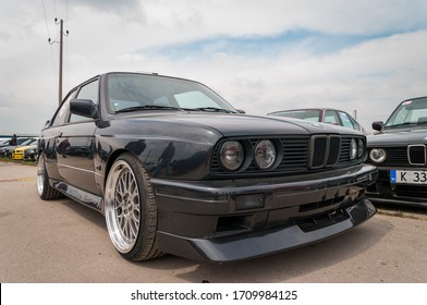 London, England - June, 1st 2014: Retro BMW M3 ( E30 ) sports car. Tribute To BMW Cars. There are many BMW, from old cars to new sports cars. Collect cars and car owners who have a preference for BMW.