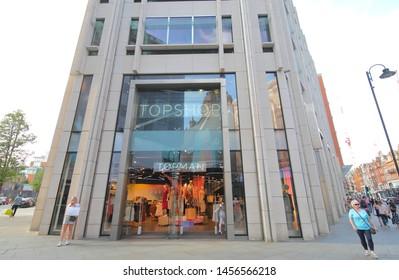 LONDON ENGLAND - JUNE 2, 2019: Unidentified people visit Topshop clothes store Knightsbridge London UK