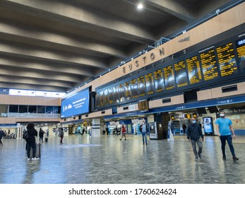 LONDON, ENGLAND - JUNE 20, 2020: An empty Euston railway station with social distancing measures in place.