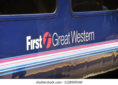 LONDON, ENGLAND - JUNE 2018: Close up view of the side of a coach in London Paddington railway station showing the logo of the train operator First Great Western.