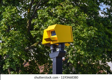 LONDON, ENGLAND - JUNE 2018: Twin electronic speed camer on the Bath Road near Heathrow mounted on a tall metal post.
