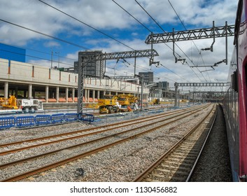 LONDON, ENGLAND - JUNE 2018: View from a train of new gantries and overhead cabling installed for the electrification of the main line from London to Wales and the South West of England