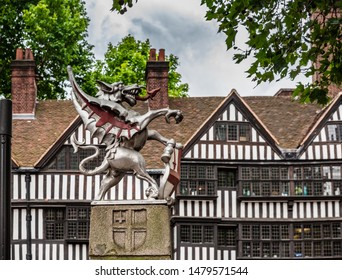 London, England, June 2019: gryphon, the symbol of the  City of London, in front of the Staple Inn  a part-Tudor building on the south side of High Holborn street