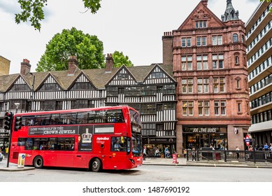 London, England, June 2019: Staple Inn  a part-Tudor building on the south side of High Holborn street in the City of London with a red double decker bus on the street