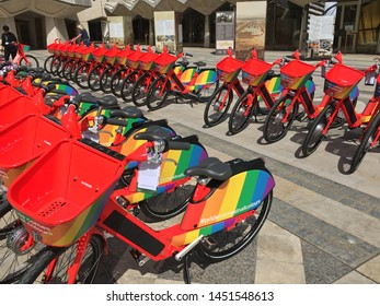 London England June 21st 2019 : Red Pride LGBT Rainbow pay as you go rental bikes, Boris bike, in lines ready to go in London city