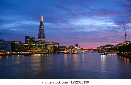 London / England — June 23, 2018: sunset view of the River Thames in London in the evening from the Tower Bridge with the Shard, City Hall, Southwark and London Bridge