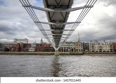 LONDON, ENGLAND - JUNE 23, 2019: Millennium Bridge over the River Thames in London, England, United Kingdom