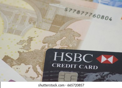 London, England - June 24th, 2017: illustrative image of HSBC credit card with Euro currency. HSBC Bank plc is one of the largest banking and financial services organisations in the world.