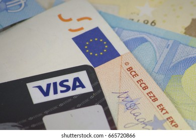 London, England - June 24th, 2017: illustrative image of Visa credit card with Euro currency. Visa Inc. is an American multinational financial services corporation.