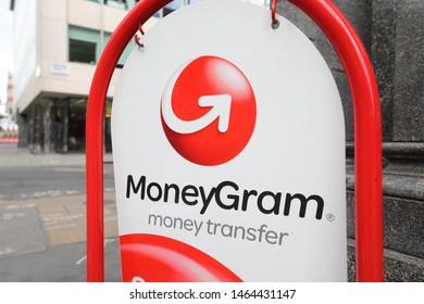 LONDON ENGLAND - JUNE 3, 2019: MoneyGram money transfer company sign
