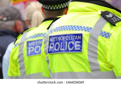 LONDON ENGLAND - JUNE 4, 2019: Police officer control protest against Donald Trump London UK