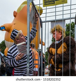 London, England, June 4, 2019. A Boris Johnson character holds a copy of the Mueller Report whilst a Donald Trump character is behind bars during President Donald Trump's State Visit to the UK.