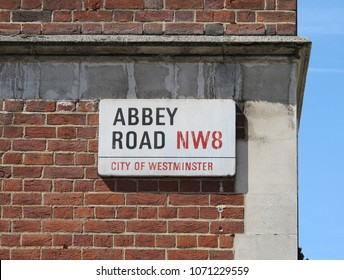 London, England - June 5, 2013: An Abbey Road NW8 - City of Westminster street sign is shown. This street is home to Abbey Road Studios, which was extensively used by The Beatles in the 1960s.