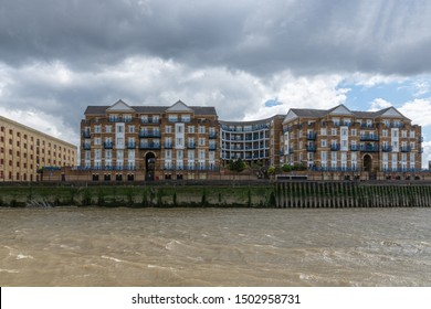 LONDON, ENGLAND - JUNE 7, 2019: London, Thames river with famous London skyline far behind, under dramatic sky.
