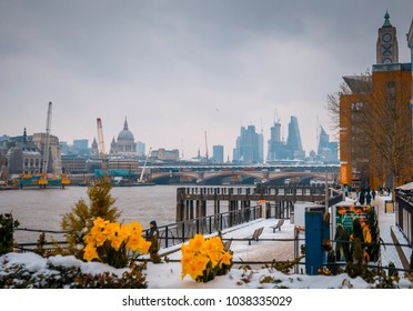 London, England - March 01, 2018: Snow covers the Footpath along the South Bank London after the Beast from the East hit Central London.