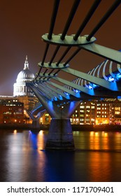 London England - March 05 2013: Night time view of the Millenium Bridge over the River Thames with St. Paul's Cathedral illuminated in the background