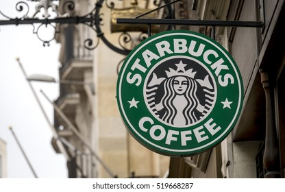 London, England - March 09, 2015: Starbucks Coffee Shop Sign, Starbucks is the largest coffeehouse company in the world, Founded in Washington, 1971.