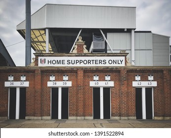 LONDON, ENGLAND - MARCH 1, 2019: View of the turnstiles entrance to Craven Cottage in London, England