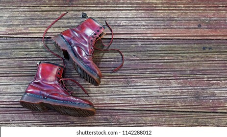London, England - March 15, 2014: Worn Pair of Dr Martens Leather Lace up Unisex 8 Eyelet Boots in Oxblood Colour.