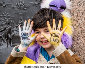 London, England - March 15  2019:  a little children protest during the youth climate strike in the Fridays for future.