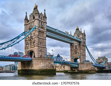 London, England - March 18 2020: Double Decker Buses Going Through Tower Bridge