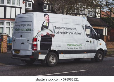 LONDON, ENGLAND - MARCH 1st, 2017: Waitrose home delivery van delivering goods to a house in London.