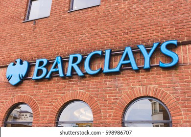 LONDON, ENGLAND - MARCH 1st, 2017: Barclays bank blue logo and sign on a orange brick wall, Harrow, London, UK.