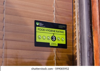 LONDON, ENGLAND - MARCH 1st, 2017: Food hygiene rating sign on a window, England, UK.