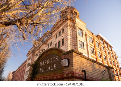 London, England - March 2021: Harrods Village (former Harrods Furniture Depository) is a Grade II listed prestigious gated development offering sought-after apartments and penthouses along the Thames.
