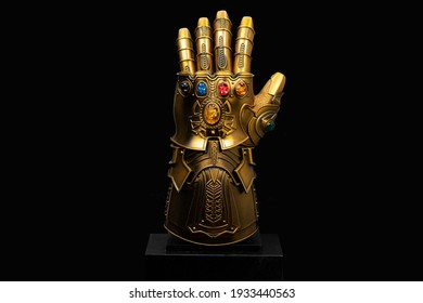 LONDON, ENGLAND - March 2021: Thanos's Infinity Gauntlet with infinity stones as seen in the Avengers Infinity War and Endgame movies produced by Marvel Studios.
