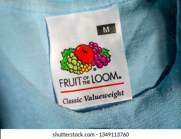 London, England - March 25, 2019: Fruit of the Loom Logo inside an item of clothing, Fruit of the Loom is an American  clothing manufacturer founded in 1851.