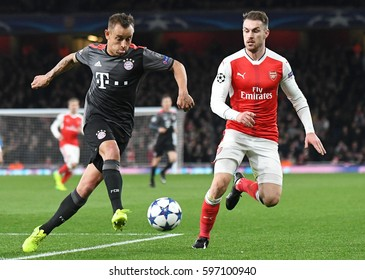 LONDON, ENGLAND - MARCH 7, 2017: Rafinha and Aaron Ramsey pictured during the UEFA Champions League Round of 16 game between Arsenal FC and Bayern Munich at Emirates Stadium.