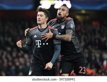 LONDON, ENGLAND - MARCH 7, 2017: Robert Lewandowski and Arturo Vidal celebrate after a goal during the UEFA Champions League Round of 16 game between Arsenal FC and Bayern Munich at Emirates Stadium.