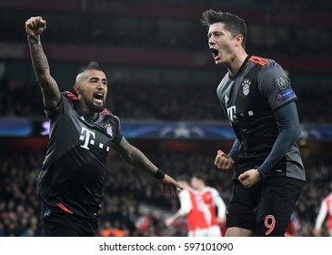 LONDON, ENGLAND - MARCH 7, 2017: Arturo Vidal and Robert Lewandowski celebrate after a goal during the UEFA Champions League Round of 16 game between Arsenal FC and Bayern Munich at Emirates Stadium.