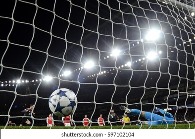 LONDON, ENGLAND - MARCH 7, 2017: Robert Lewandowski scores from a penalty during the UEFA Champions League Round of 16 game between Arsenal FC and Bayern Munich at Emirates Stadium.