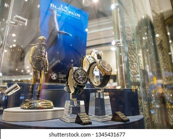LONDON, ENGLAND - MARCH 8, 2019: Blancpain Fifthy Fathoms sports diving timepieces on display at a tax-free store at Heathrow International Airport. Travel and luxury Swiss watch industry.