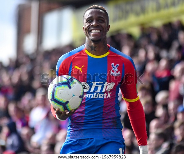 LONDON, ENGLAND - MARCH 9, 2019: Wilfried Zaha of Palace pictured during the 2018/19 Premier League game between Crystal Palace FC and Brighton & Hove Albin FC at Selhurst Park.
