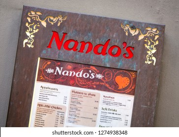 London, England - May 04, 2014: Nando's Restaurant Sign, Nando's is a casual dining restaurant chain originating from South Africa, with a Mozambican/Portuguese theme, founded in 1987.