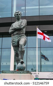 LONDON, ENGLAND - MAY 05, 2012 :  Bobby Moore statue outside Wembley Stadium. A legendary footballer and England captain who lead the team won World Cup 1966,  regarded as one of the best defenders.